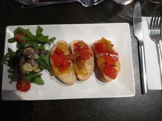 La Casa Italian: BRUSCHETTA CON PEPERONI SALTATI Toasted ciabatta, sauteed mixed peppers, mixed herbs.