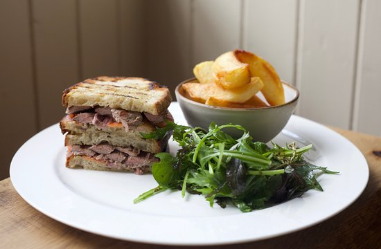 Norbury, UK: We always have a great sandwich on our lunch menu. This is a steak sandwich with triple cooked chips and Lane Cottage leaves.
