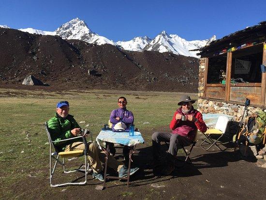 Eastern Region, Nepal: Advent Himalaya Treks guiding to Kanchanjanga Base Camp Trek. Clients are enjoying with cup of coffee, clear Mountain views.