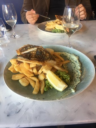 grilled fish and chips, unfortunately tough, flavourless and frozen