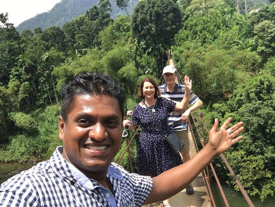 """Clients on a bridge over the Maskeliya Oya, a tributary of the Kelani river where in 1957 the film """"The Bridge on the River Kwai was filmed"""