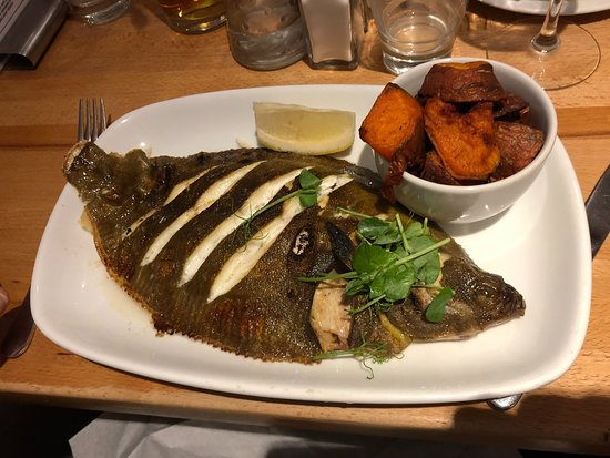 Whole grilled plaice with sweet potato wedges