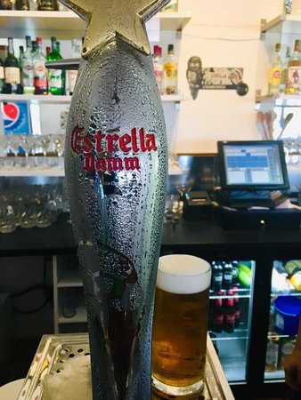 """The Smokehouse and Tapas Bar : One of our Beers on draught """"Estrella Damm Barcelona"""""""
