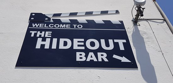 ‪The Hideout Bar‬