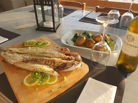 Grilled fresh fish, accompanied with a Portuguese white Douro!!  I`m in love.. ;)
