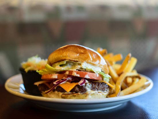 Cole Harbour, Canada : 6 ounces of angus ground chuck dressed with fresh ingredients and gourmet condiments held together by a warm, grilled bun that is soft on the inside with a slightly crispy bite. Oh my!