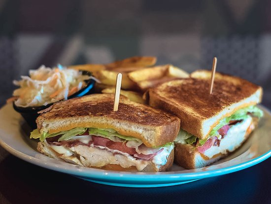 Cole Harbour, Canada : Grilled chicken breast topped with lettuce, tomato, bacon and cheddar cheese served between two pieces of grilled garlic bread dressed with our homemade Bacon Parmesan Mayo!