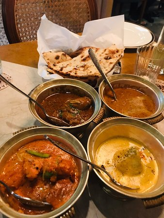 Melange of butter chicken with daal Makhani, chicken curry with malai kofta and the delicious chur chur naan. The food here is excellent