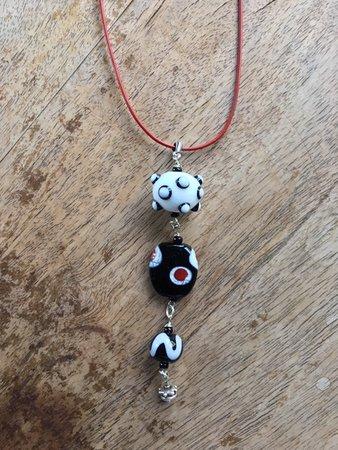 Handmade glass beads I had made into a necklace.