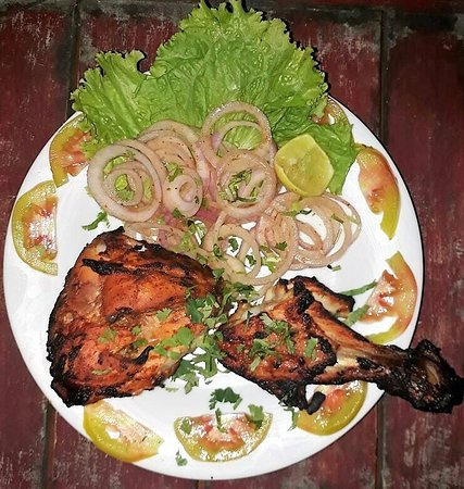 Akkaraipattu, Sri Lanka: Thandoor Chicken 1/4. Its marinated with Indian spices and Grilled in Glay oven.