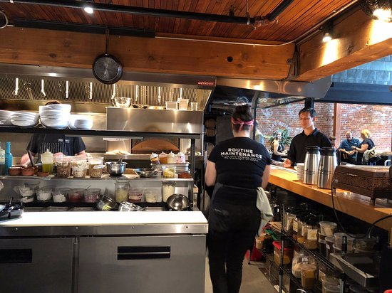 Shalom Y'all: Great view of the kitchen.  It was also a quiet area in a noisy place. Note the t-shirt saying.