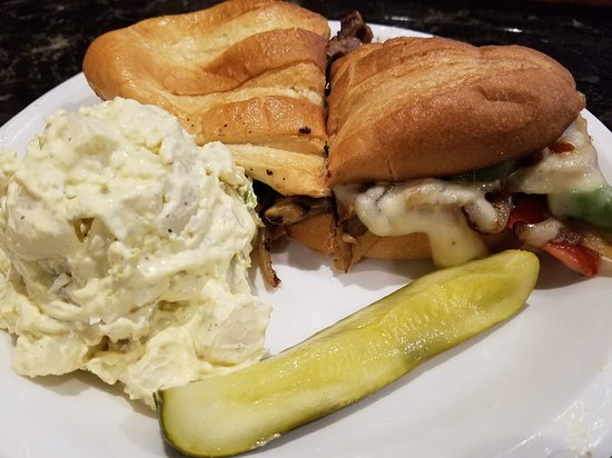 Sam's Town Sports Deli: Philly Cheesecake Sandwich, with potato salad  $8.99. Homemade potato salad.