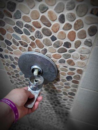 Shower handle broken, rusty and old