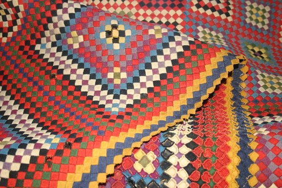 Magnificent military quilt made by a soldier in the mid 1800s. All the pieces were military uniforms.