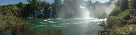 Studenci, Bośnia i Hercegowina: Pan of full waterfall.