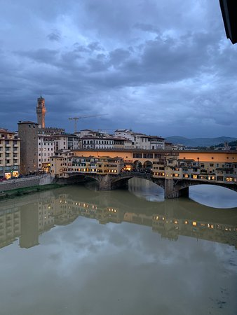View at dusk of the Ponte Vecchio from Hotel Lungarno
