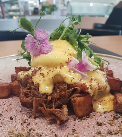 Our twist on a eggs benny, poached eggs, hollandaise, potatoe roasties with sumac pulled pork with apple butter