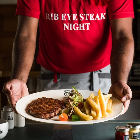 Belgian Cafe: Enjoy deliciously prepared rib-eye grilled to perfection, served with Belgian fries, garden salad and a sauce of your choice