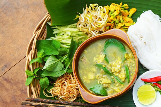 """Kravanh Sothearos Blvd: Cambodia's famous """"Nom Ban Chock"""" delicate fish curry served with chilled rice noodles, fragrant herbs, flowers and salad vegetables. Ours is a recipes passed down generations of family matriarchs."""