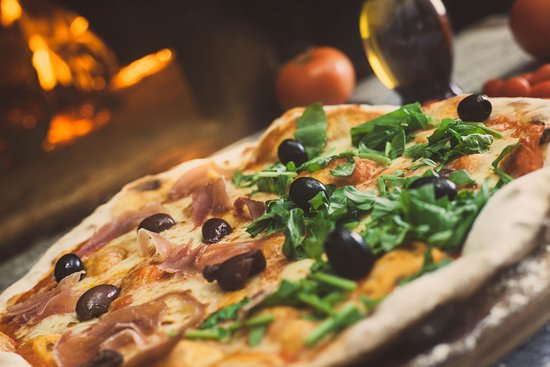 WOOD-OVEN PIZZAS MADE WITH PASION SINCE 1999.