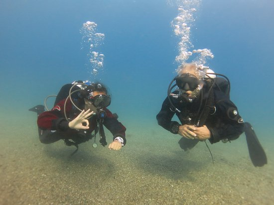 Discover Scuba Diving Portofino & Christ of the Abyss: David and Madison. Nicco took the pictures.