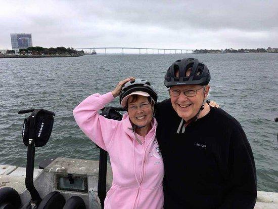 San Diego Early Bird Segway Tour: Happy couple taking a break, Jeff took a great pic! That's the Coronado Bridge in background.