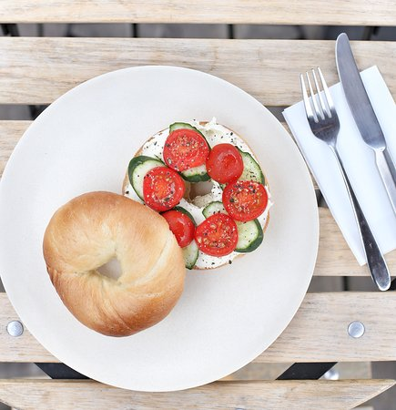 Housebaked bagel with tomato-cucumber