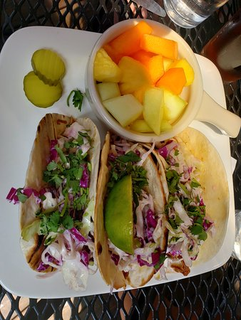 Iron Tap: pulled pork tacos with fresh fruit side.
