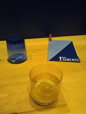 Water glass, cocktail and menu