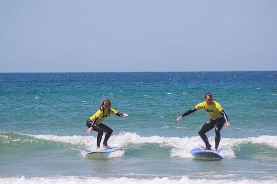 Experiencia de surf - Traslado a...
