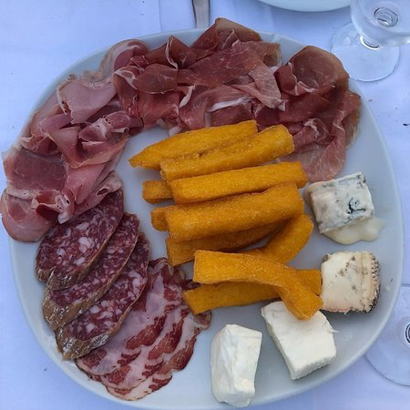 assorted cold cuts with fried polenta and cheeses