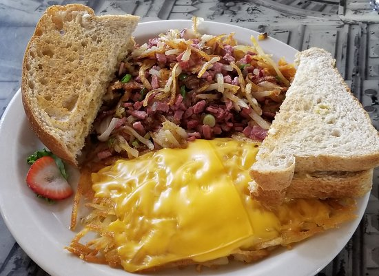 Stockton, IL: corned beef hash with cheddar covered hash browns and wheat toast which was buttered