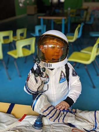No big deal, just checking out this REAL spacesuit worn in space by an astronaut...and wearing the glove!