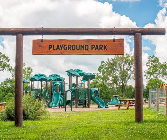 New Paris, OH: Climb, slide, jump, and ride in the spacious Playground Park. The adults can relax on outdoor picnic tables, benches, and swings while children play. Ditch the electronics and enjoy the outdoors!