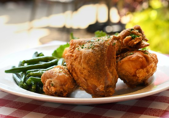 Enrico's Italian Dining: One half of chicken, seasoned, lightly-breaded and fried to perfection! Served with hot garlic bread and your choice of side.