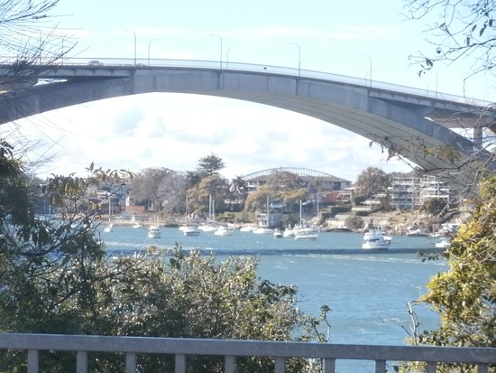 Closer view of Gladesville Bridge and water craft on Parramatta River.