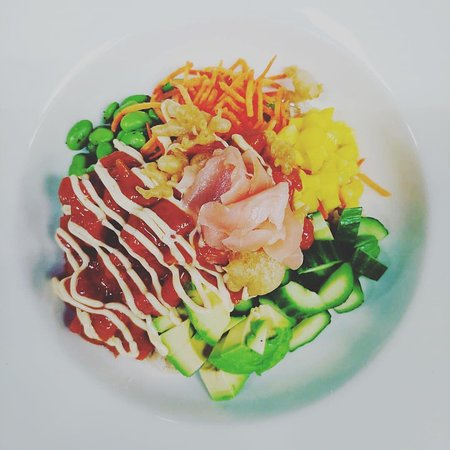 Tuna Poke Bowl  brown rice, avocado, cucumber, mango, edamame, carrot, pickled ginger, spicy aioli, crispy tempura