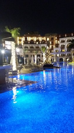 Evening view of main hotel from the bridge across one of the pools