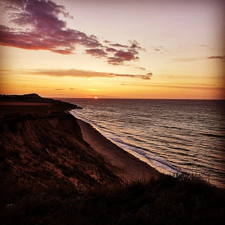 ‪‪East Runton‬, UK: Sunset seen from Woodhill August 2019‬