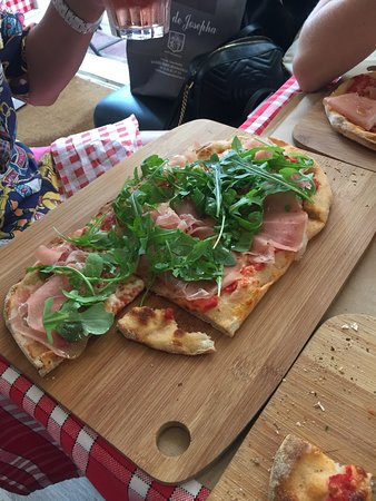 Superb pizza , flat bread and friendly service
