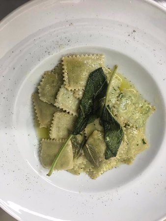 Homemade Ravioli filled with spinach and ricotta cheese flavored with butter and sage