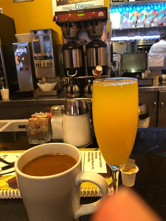 Mimosa and coffee at the counter.