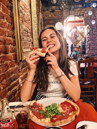 Happy client eating our delicious pizza! 🍕