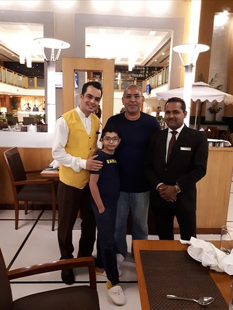 Ramada by Wyndham Jaipur: Friendly Mr Rakesh, on the right, and a staff member at the hotel restaurant