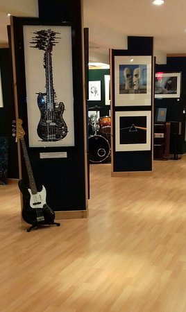 Basement Gallery view showing Bass guitar x-ray artwork by Horace Panter (Bass player with The Specials band) Our drum kit from Bill Legend ( T-Rex drummer) War of the Worlds artwork signed by Jeff Wayne and Pink Floyd album cover artwork from Storm Thorgerson.