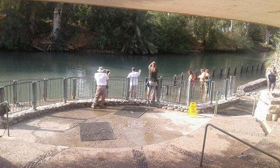 8 Days Footsteps of Christ Holy Land Tour to Israel: The Jordan River, Jesus was baptized by John the Baptist. Yardenit baptismal site.