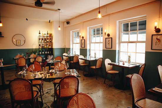 Cosy in Winter and sunny in Summer. Our dining room is the perfect spot for a long lazy lunch or dinner with friends!