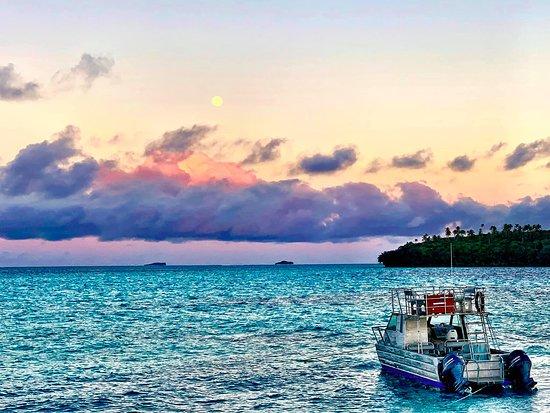 Mounu Island, Tonga: View from Mounu with Whale Swimming boat