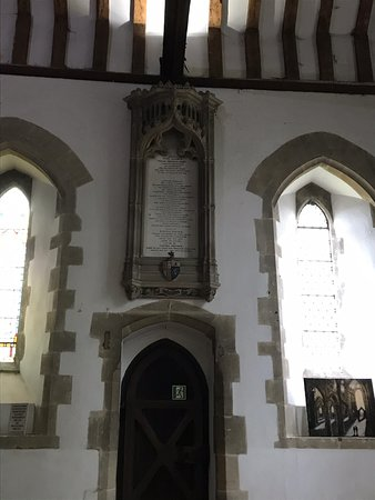 Interior features and unusually shaped tombstones in the churchyard