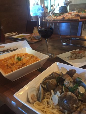 Great Italian restaurant. Best spaghetti w baby clams. Awesome New York style pizza. Happy hour all day until 10 PM. Awesome veal bolognase. Very decent merlot by the glass. I think it's a must in Miami.